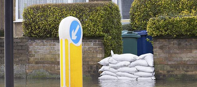Sandbags Outside House On Flooded Road