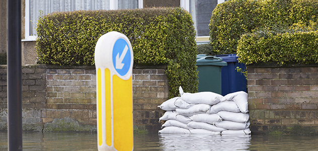 Sandbags Outside House On Flooded Road