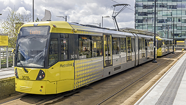 View of a Manchester Tram pulling into the station at Salford Quays, Manchester.