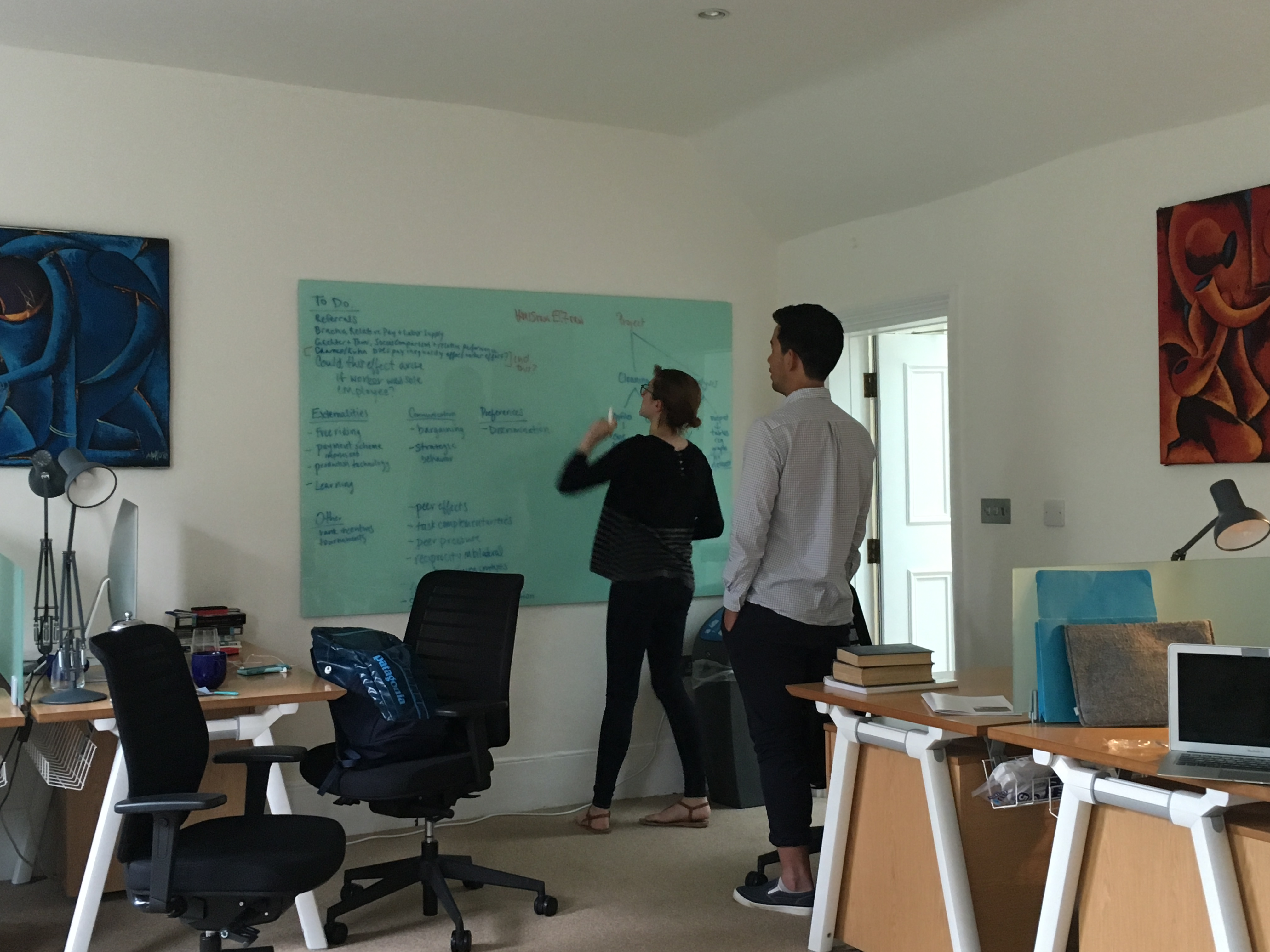 Kim Sarnoff and Shotaro Nakamura at work in the research office