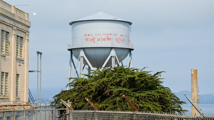 An Alcatraz water tank with graffiti