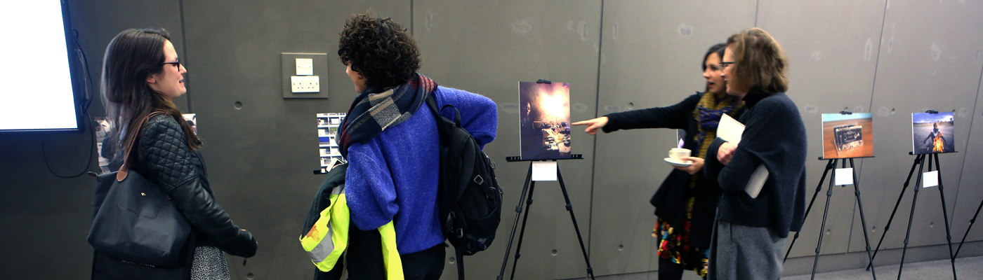 A selection of photographs lined up in a row at an exhibition | LSE festival research competition