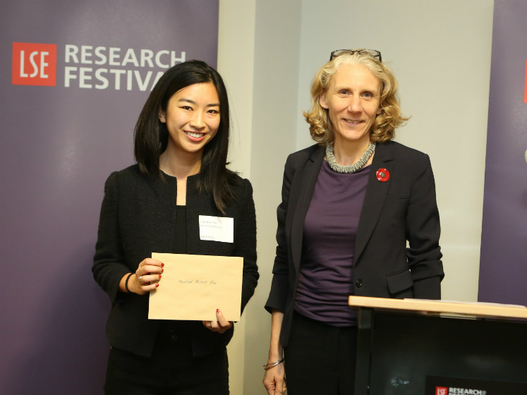 Julia Black and a winning student on the prize podium | LSE festival research competition