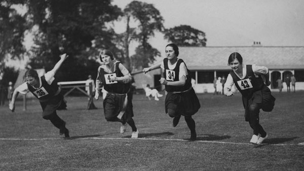 Four women run a race at LSE Sports Day, Malden Sports Ground, c1920s