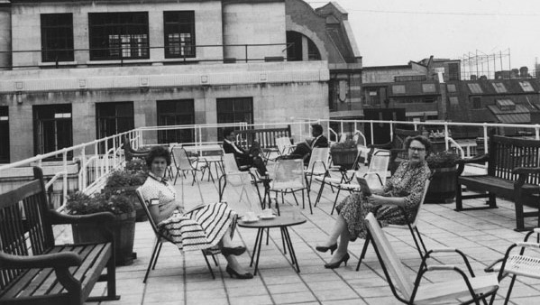 Two women sit in deckchairs on Bowley Roof Garden in 1960