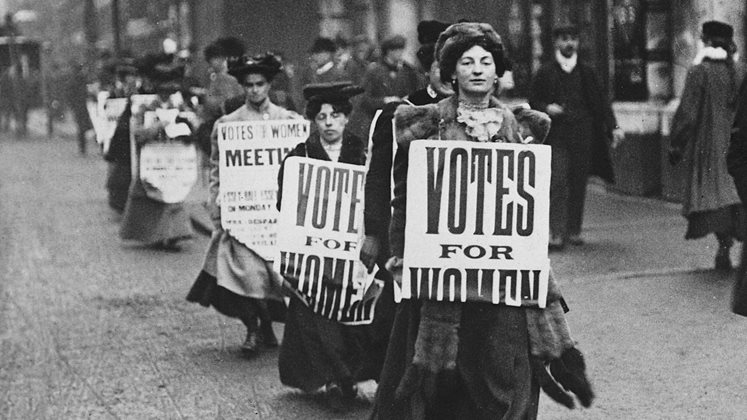 Suffragettes marching in a London street