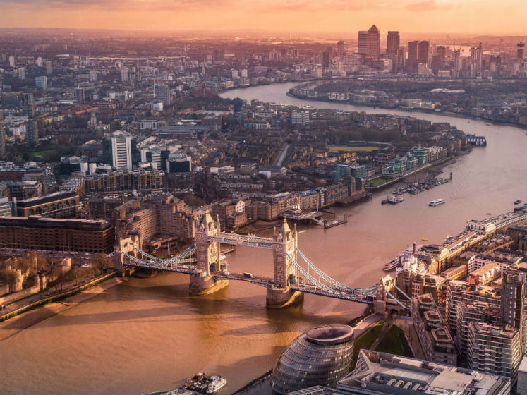 An aerial shot of Tower Bridge in London at sunset