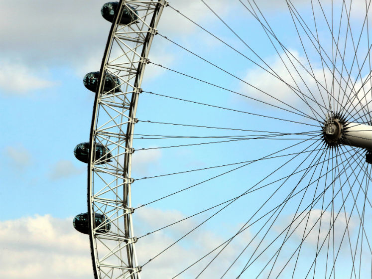 A close-up of the London Eye showing the structure and pods