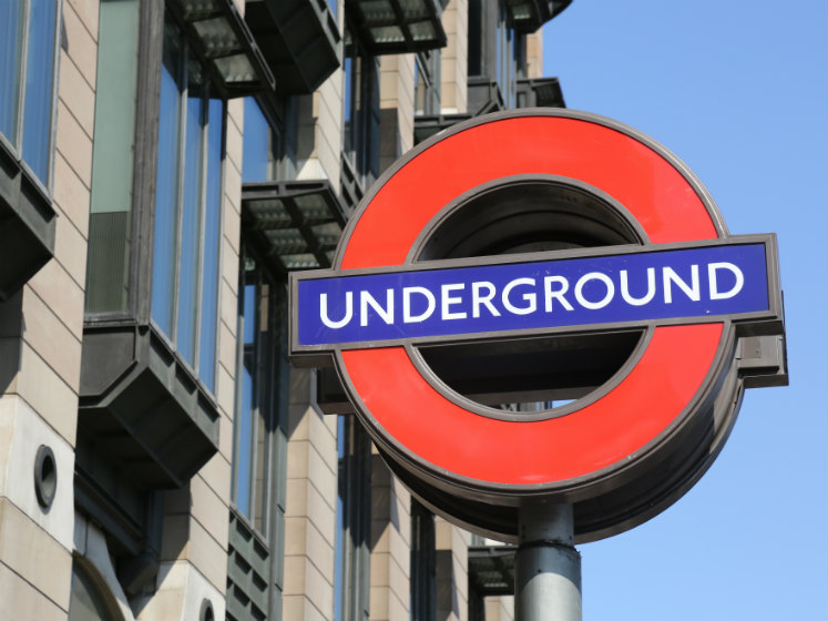A red and blue sign of the london underground
