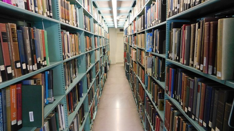 archive-books-library-shelves-747x420