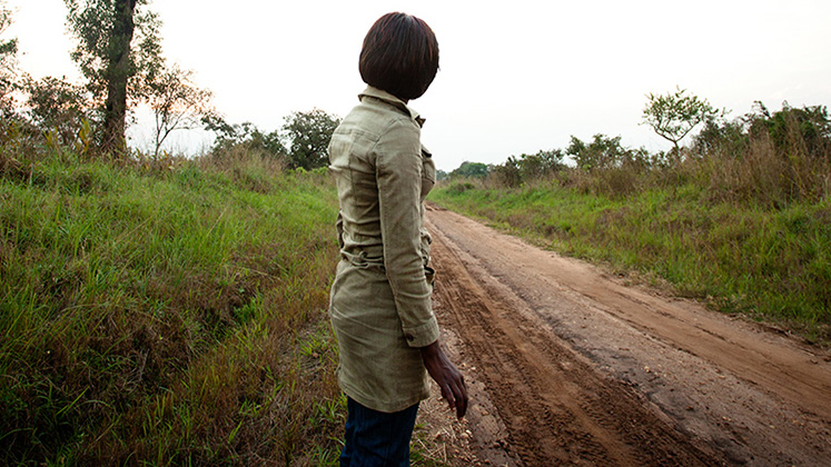 A woman, formerly part of the LRA, looks for transport to return to the city