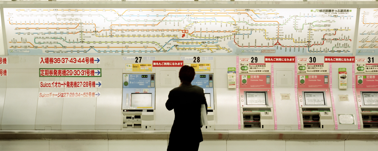 Tokyo subway person looking at ticket machine