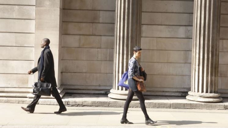 Two financial workers walking