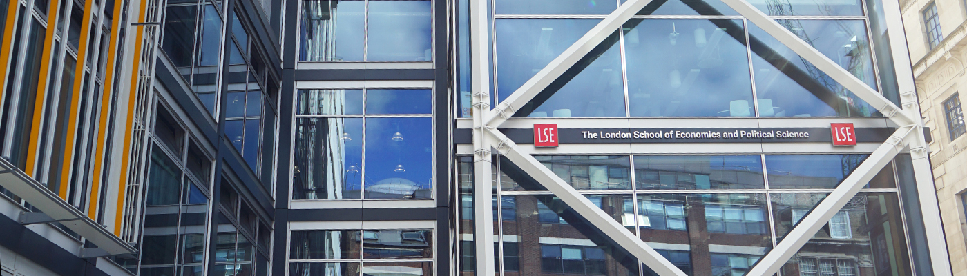 Abstract photograph of the LSE Government building with clouds reflected in the glass architecture.
