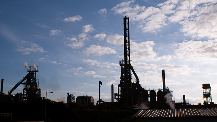 Port Talbot Steel Works in South Wales silhouetted in the evening sun.
