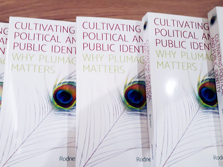 Several copies of the book 'why plumage matters'
