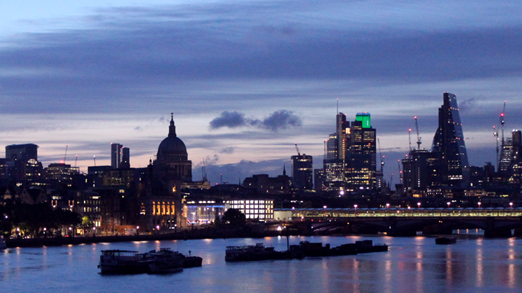 A twilight picture of the London skyline taken from Waterloo Bridge looking towards St Pauls'