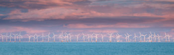 Wind Farm in motion at Sunset in the Solway Firth.