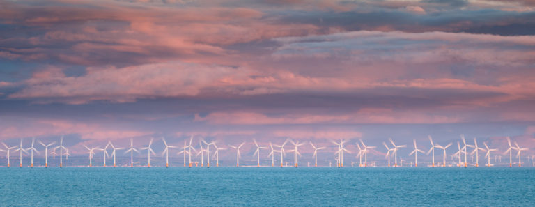 Wind Farm in motion at Sunset in the Solway Firth