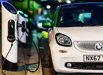 Smart electric car charging in the London Street st night.
