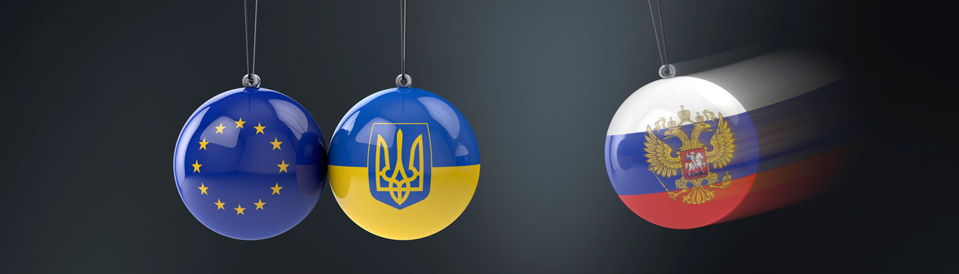 Avoiding a New Cold War? European Union, Ukrainian, and Russian flags