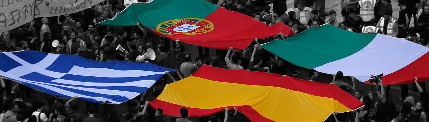 Portuguese, Italian, Greek, and Spanish flags in crowd