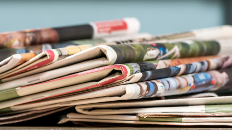 stack-of-newspapers-747x420-16-9