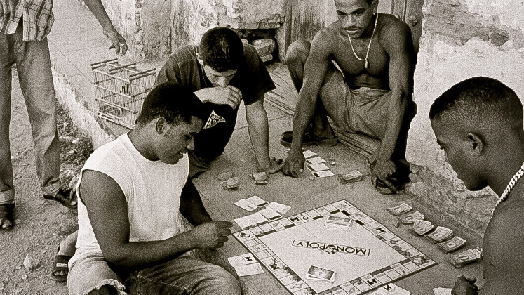 young men playing Monopoly in the street in Cuba