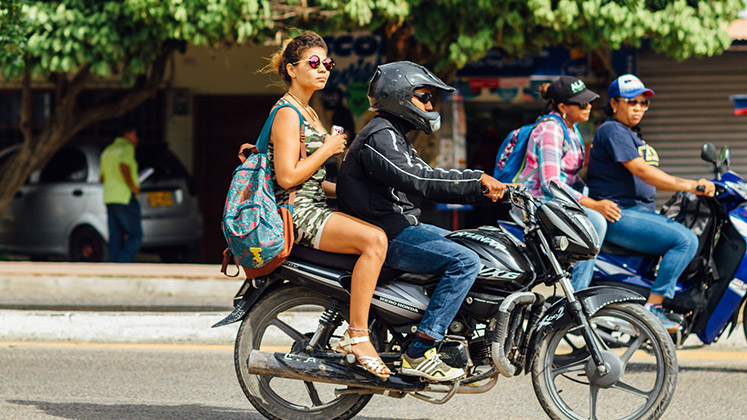 Woman Riding Moto-Taxi Colombia - Adam Cohn 747x420