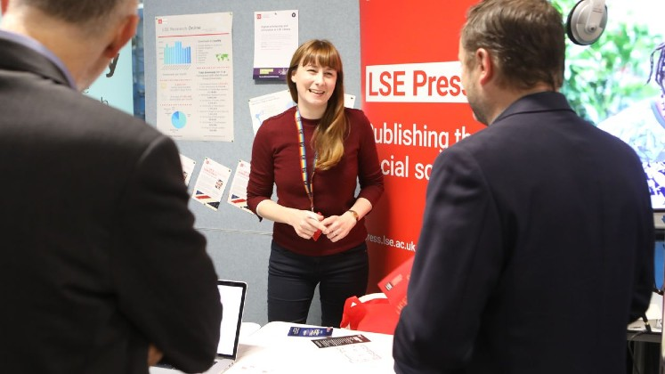 Lucy Lambe, Scholarly Communications Officer, at the LSE Press stand at the LSE Research Showcase.