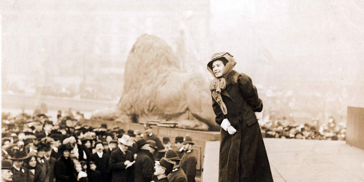 A woman talking to a crowd at Trafalgar Square in London.