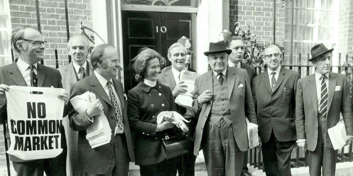 A group of political figures in the 1970s posing outside 10 Downing Street prior to delivering a petition against the Common Market.