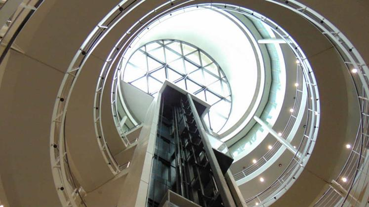 A view upwards to the dome that takes in the stairs and the lift shaft.