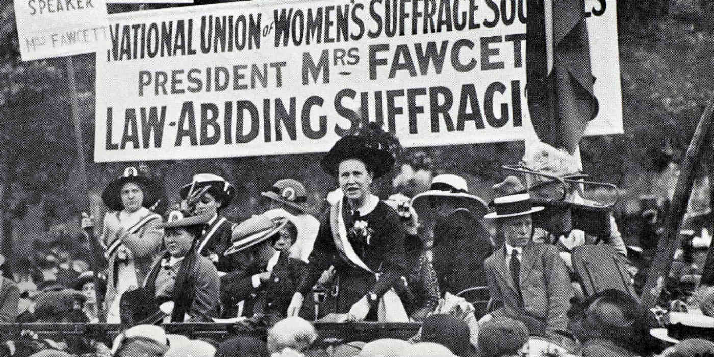 Millicent Fawcett at Hyde Park in London talking to a crowd of suffrage supporters.