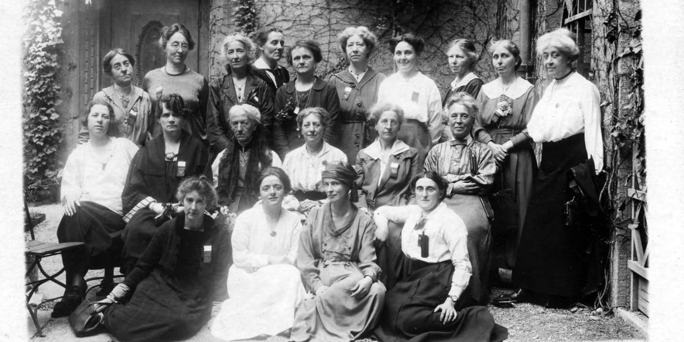 A group photo of about 20 women who were British delegates to a conference.