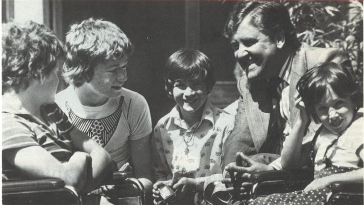 A photograph of Alf Morris MP with children dating to 1978, slightly cropped.