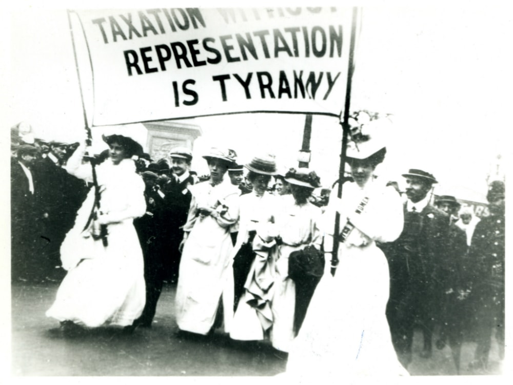 A suffrage parade in the 1900s