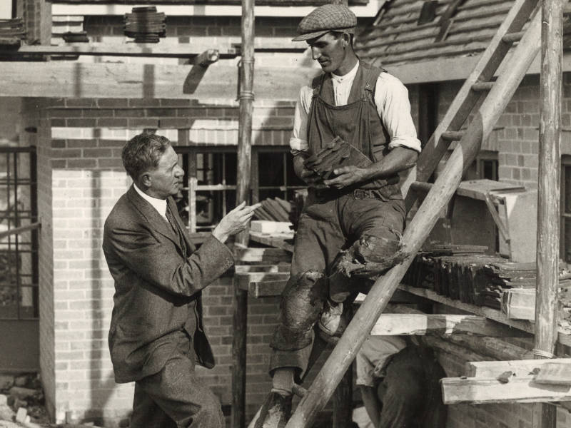 Walter Citrine talking to a tiler working on Tolpuddle Cottages, 1934 800x600