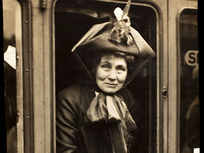 Emmeline Pankhurst looking out of a train window.