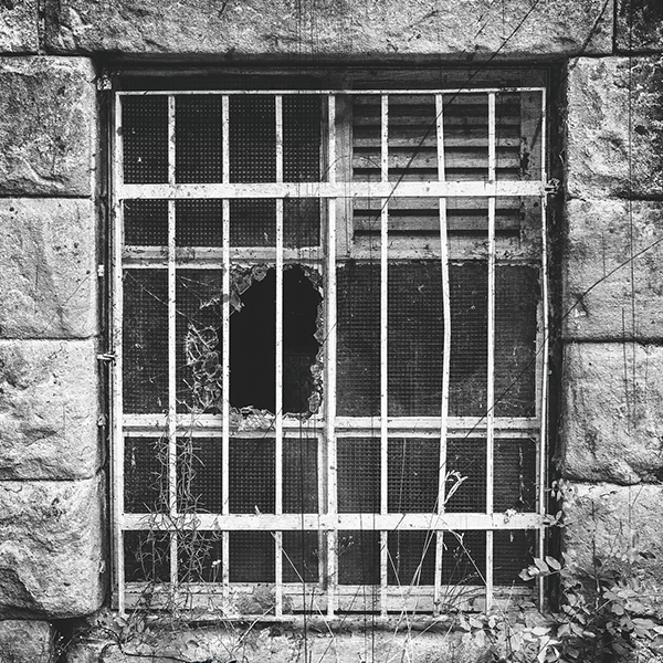Image of a broken window in a prison