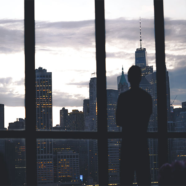 Silhouette of a man looking over the New York skyline