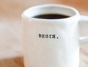 Cup of coffee saying begin