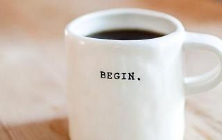 Cup of coffee saying begin