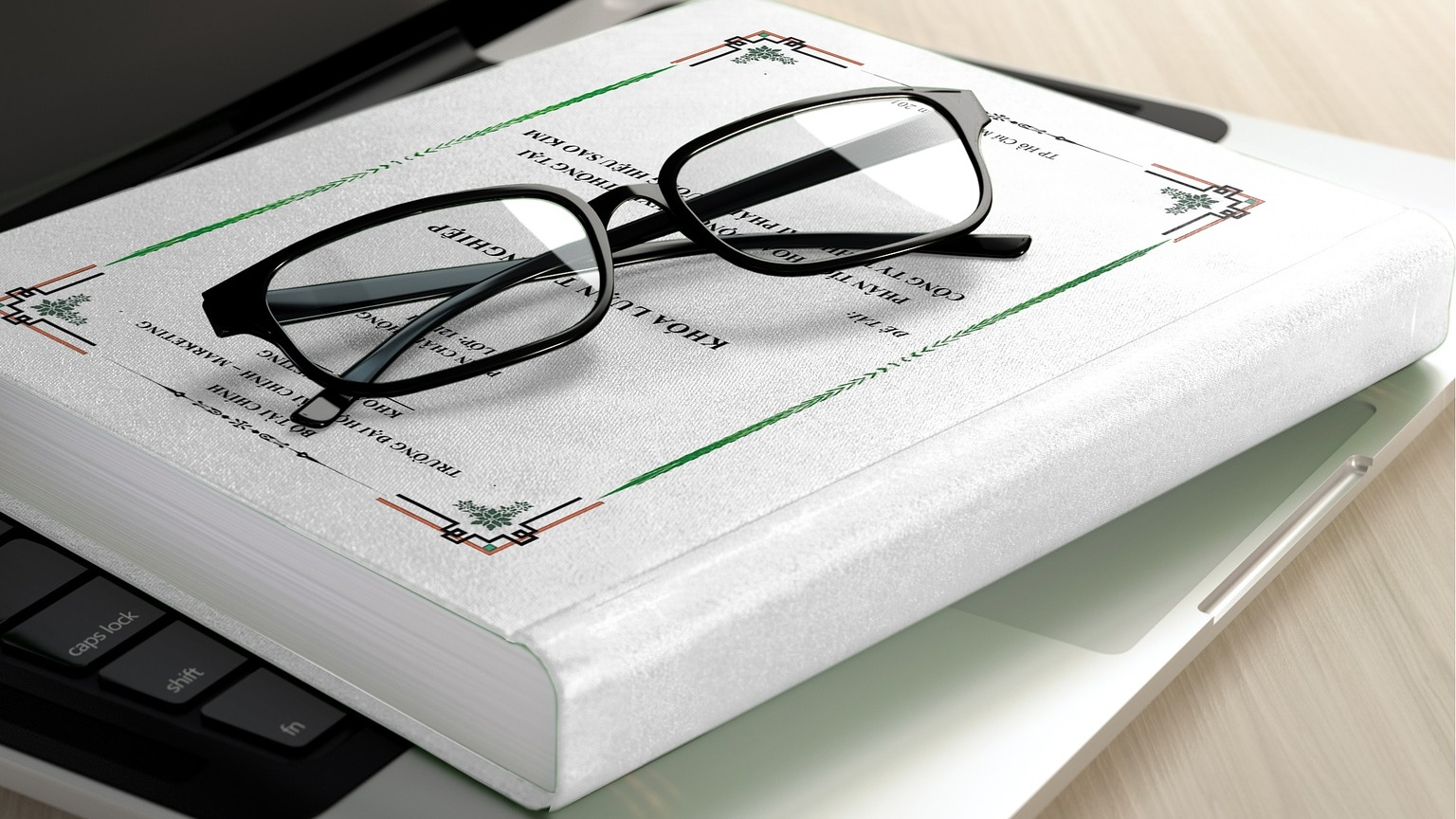 A pair of glasses on a closed book