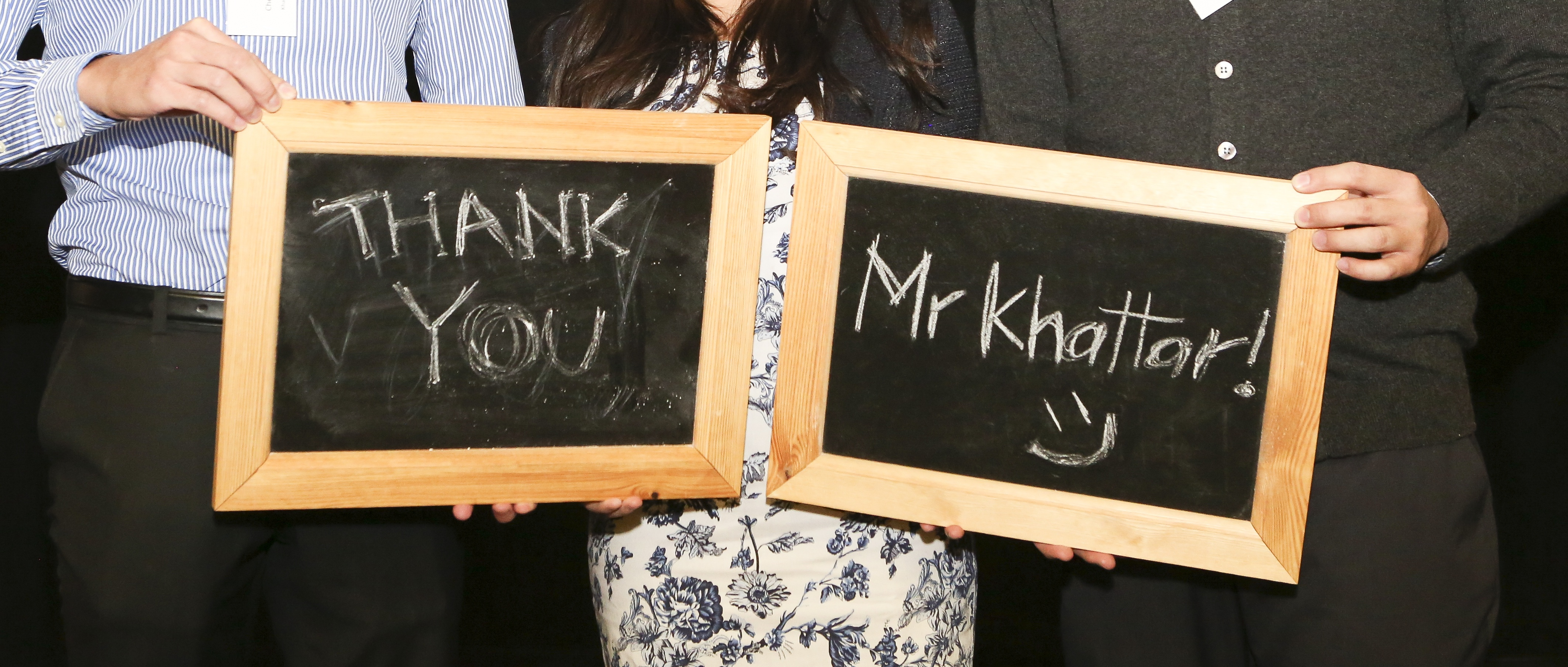 Scholars holding chalk boards thanking Mr Khattar