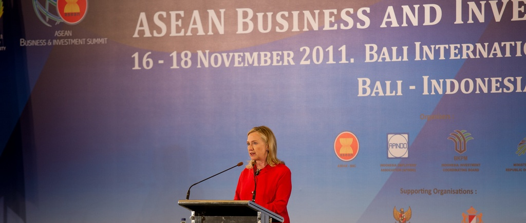 Hillary Clinton standing at a podium at the ASEAN business conference