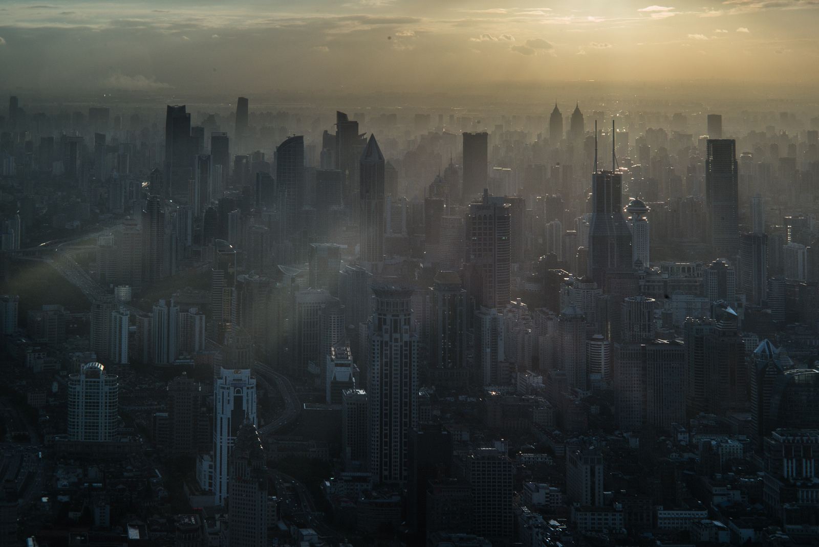 Sunshine breaking through smoggy skyscrapers in Shanghai