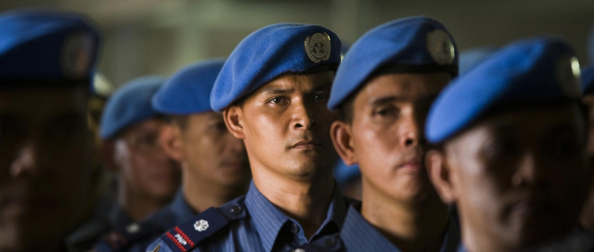 UN peacekeepers in blue berets in a line