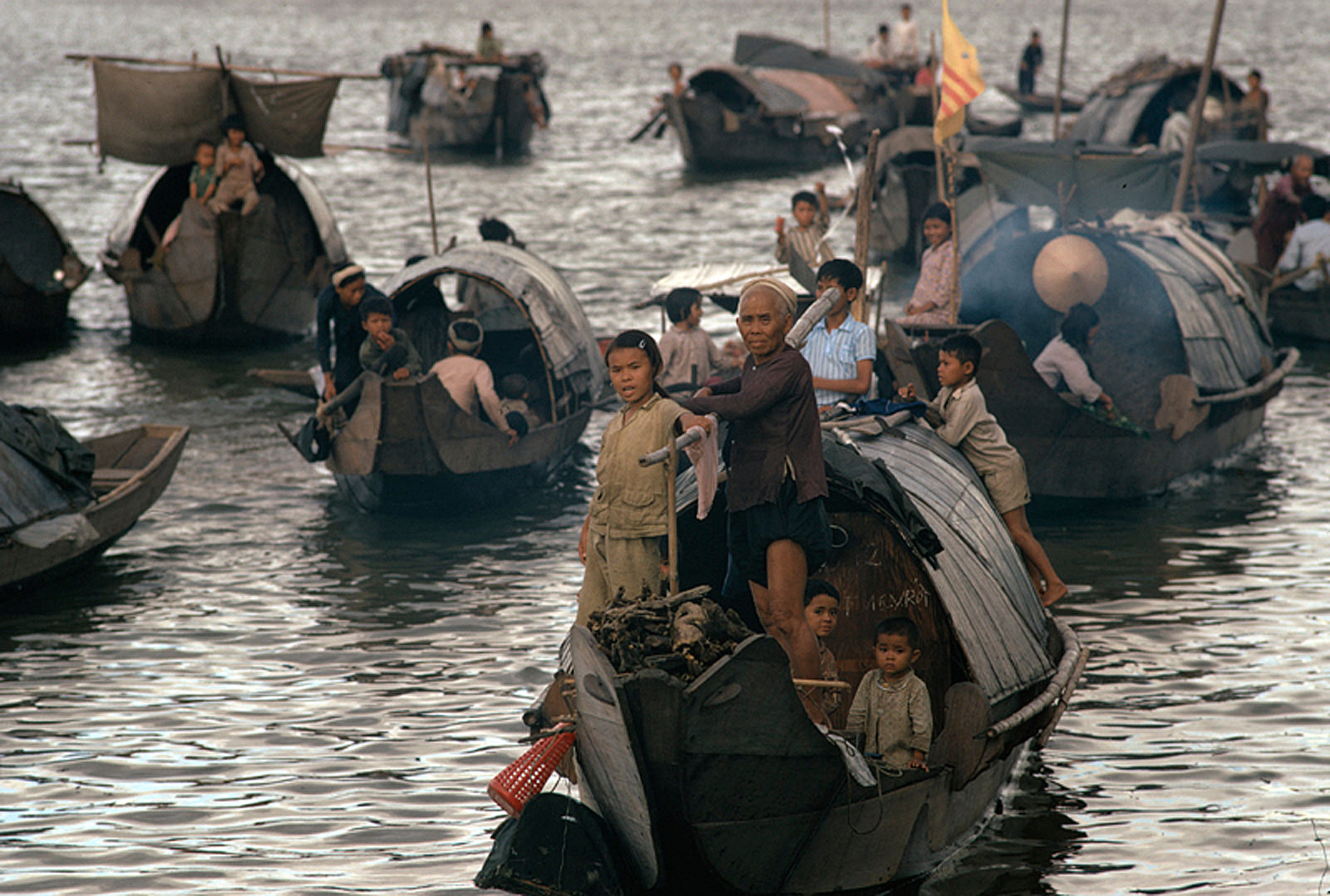Vietnamese migrants in small boats at sea