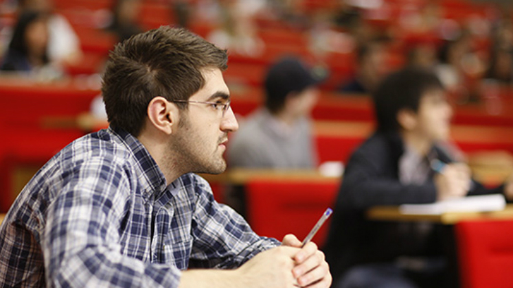 A student in an LSE lecture theatre